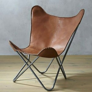 Aged leather industrial butterfly chair